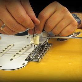Riparazione chitarre e bassi